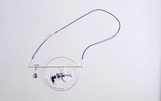 Tal Efraim Necklace: Target, 2016 Silver, porcelain, rutilated quartz,textile string 12 x 7 x 1 cm Photo by: Ilan Besor From series: Connectionary: