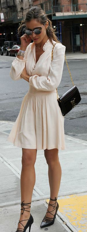 This cute cream dress looks simple but effective with strappy black heels and a YSL bag. Via Silvia Zamora.  Dress: Maje, Shoes: Aldo.