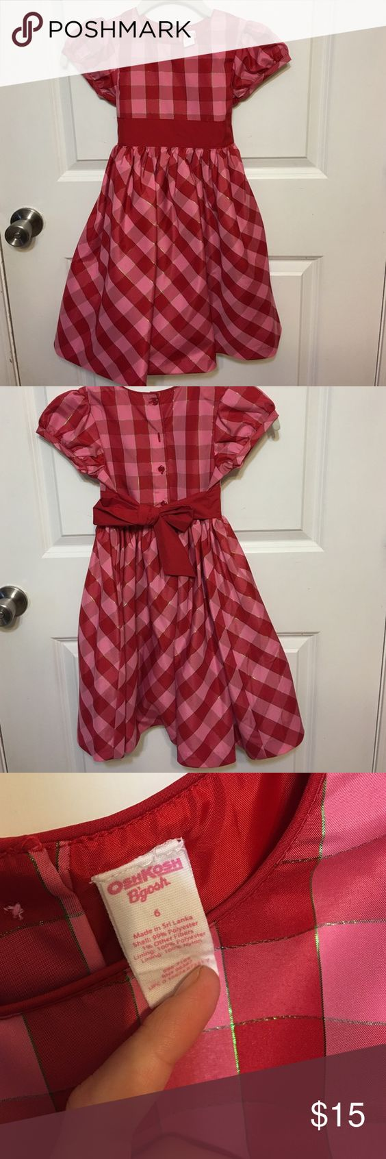 Adorable red and pink dress *PERFECT FOR THE HOLIDAYS* Osh Kosh Bgosh red and pink plaid dress with iridescent small green accents. Red ribbon tied belt with buttoned down back. Tulle under lining. Never worn. Size 6. Osh Kosh Dresses Formal