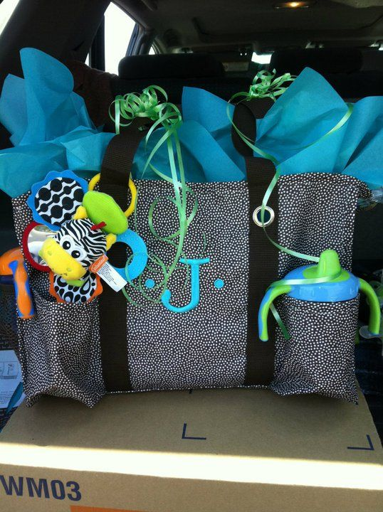 Baby Shower gift idea - Thirty-One Organizing Utility Tote filled with stuff from the mom-to-be's registry.  The O.U.T. makes a great diaper bag!