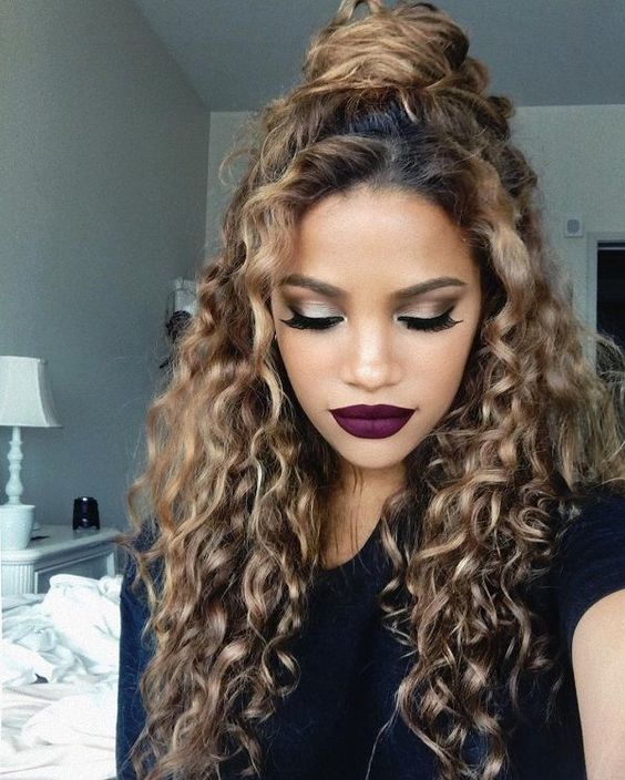 half updo hairstyle for curly hair in summer