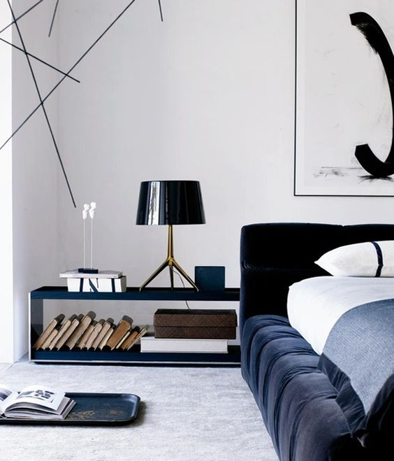 Bedroom featuring the low rise Tufty Bed by Patricia Urquiola and the Surface table by Vincent Van Duysen.