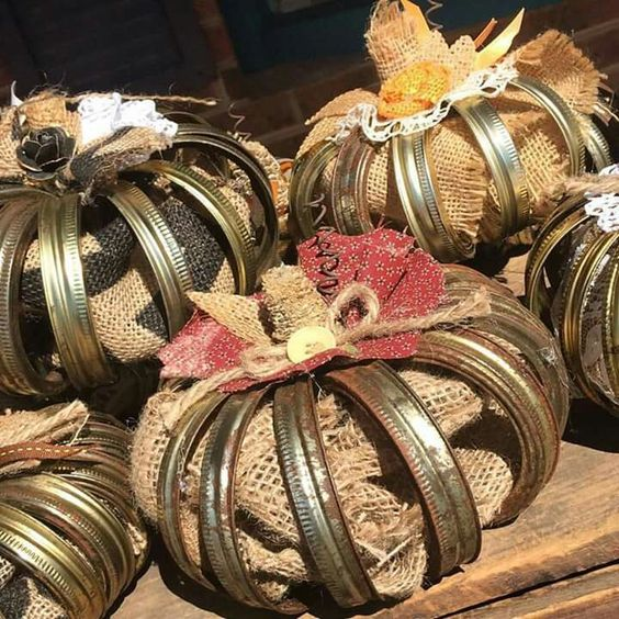 Canning jar lids and burlap make great pumpkins! Rusted Roots