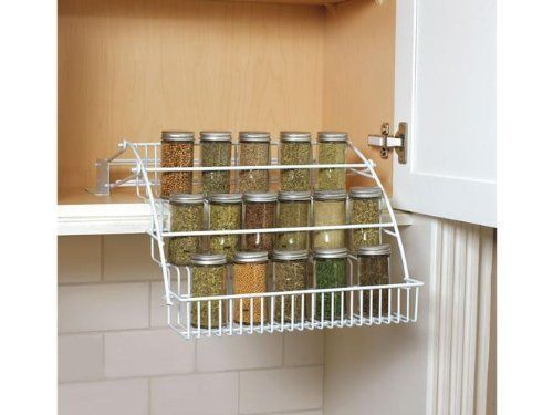 NEW Pull Down Spice Rack.  A bit pricy - PLUS shipping from the US 'cos nobody seems to sell Rubbermaid over here - but totally brilliant!  Wonder if it would fit in our medicine cabinet.  That's how I saw it being used on Pinterest.