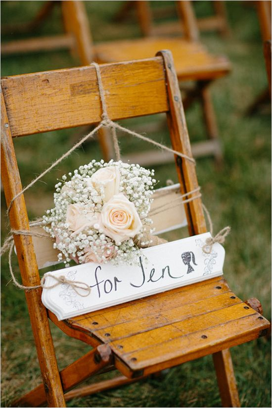 i know this is for a memorial chair.... but i love the roses and baby's breath (?) bouquet for a bridesmaid.