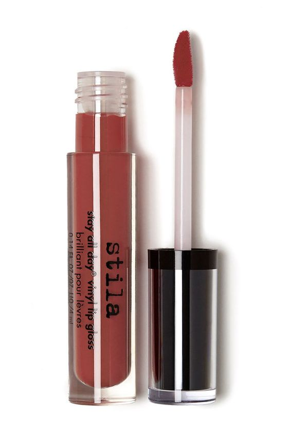 A high-shine, high pigment, high performance lip gloss that gives the appearance of a bold, lacquered lip. Unlike other long-wearing formulas, Stay All Day¨ Vinyl Lip Gloss won't dry out lips thanks to the infusion of nourishing and moisturizing ingredients including seaweed extract and organic green coffee oil. Simply sweep onto lips for an immediate burst of color and shine that stays in place through the day... and night.