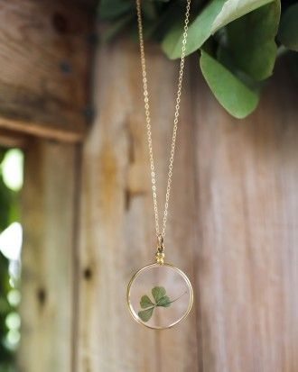 After this bride said yes, the couple immediately spotting a four-leaf clover took it home and placed it in this glass locket.