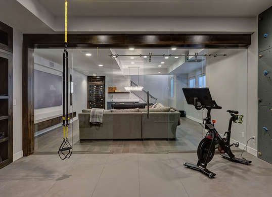 Beautiful Basements 13 Surprisingly Cool Underground Amenities In Real American Homes Home Gym Basement Finishing Basement Basement Remodeling