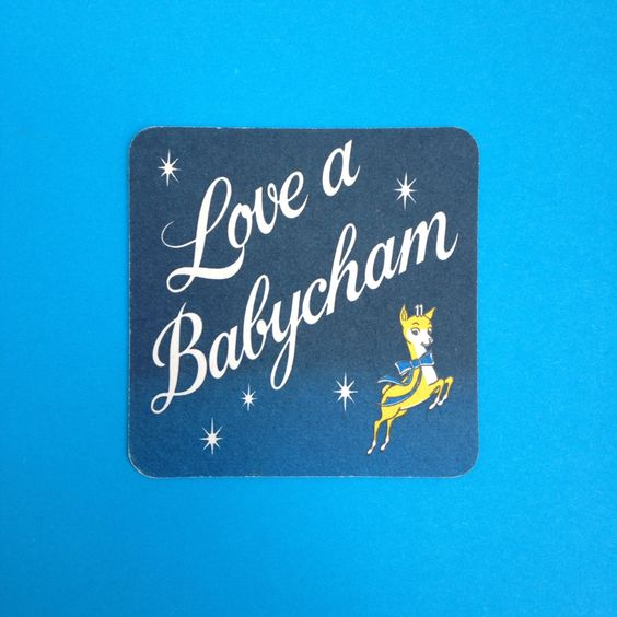 """Sweet little coaster showing the Babycham deer leaping alongside the words """"Love A Babycham"""". In reasonable condition overall (pictured) and approximately 9cm squared, fairly standard coaster size.All items are authentic vintage goods, specially selected for robertafidora.com and as such, items may show signs of wear consistent with age and use."""