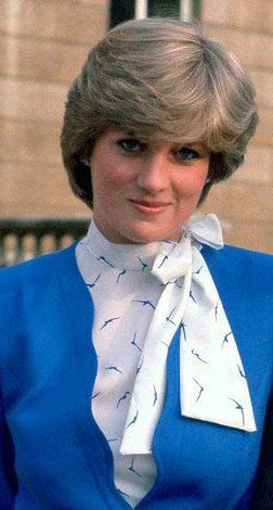 Lady Diana and her mother bought the suit she wore at her engagement announcement off the rack at Harrod's. Tina Brown says it looks like something a flight attendant would wear. Meow.