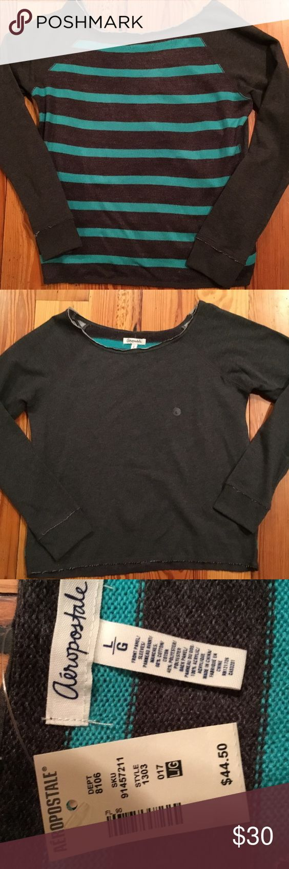 NWT FUN AEROPOSTALE SWEATER NWT AEROPOSTALE SWEATER. This is a really cute and fun top. The front is picture 2, a dark charcoal grey sweatshirt type material, the back is picture 1 a pretty teal and charcoal grey strip sweater. IN BRAND NEW NEVER WORN CONDITION. From my CLEAN NON SMOKING HOME. Check out my other items as I am cleaning out closets and listing a lot of good stuff. I DO BUNDLE. Thanks for looking.😊 Aeropostale Sweaters Cardigans