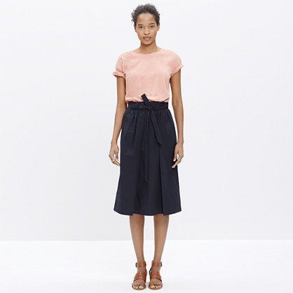 A pleated A-line skirt with a removable tie belt, this midi is ...