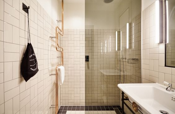 A new Hoxton Hotel opens in a 17th Century canal house in Amsterdam: En-suite bathrooms feature rain showers and copper heated towel rails.