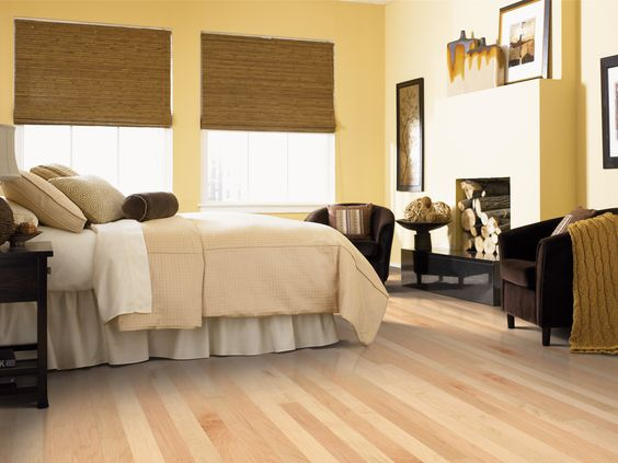 Beautiful hardwood flooring covers this brightly colored bedroom.