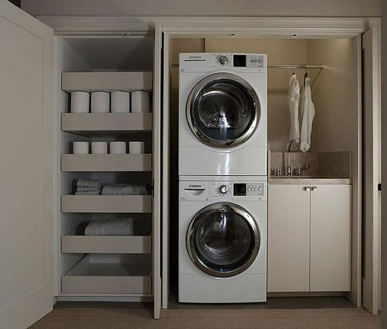 closet laundry room with stacked washer and dryer perfect