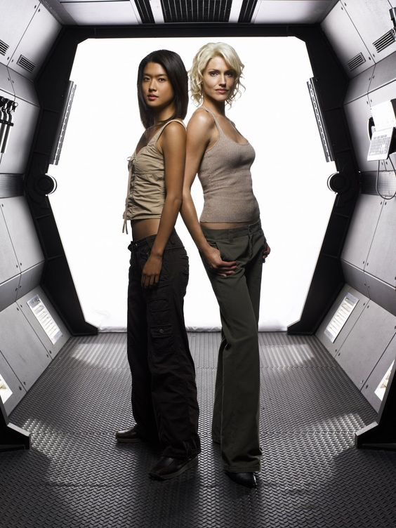 BATTLESTAR GALACTICA — Pictured: (l-r) Tricia Helfer as ...