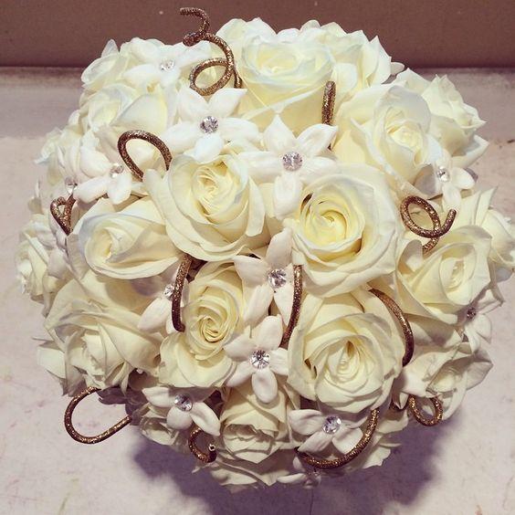Wedding bouquet of white roses, white hydrangea ...