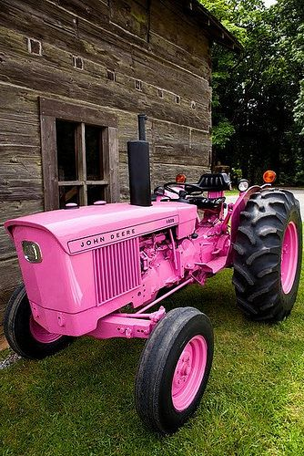 Pink John Deere tractor. I learned to drive on a tractor on the farm when I was only 11 years old. I wish mine had been pink! lol by Keith Black