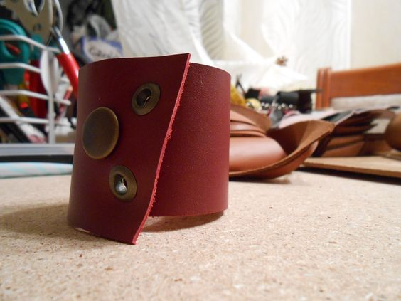Unsuccessful try to make smth nice, that turned into red leather armband.