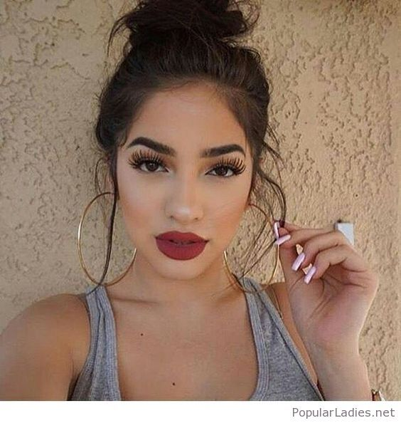 Top Bun Big Earrings And Red Lips Beauty Makeup
