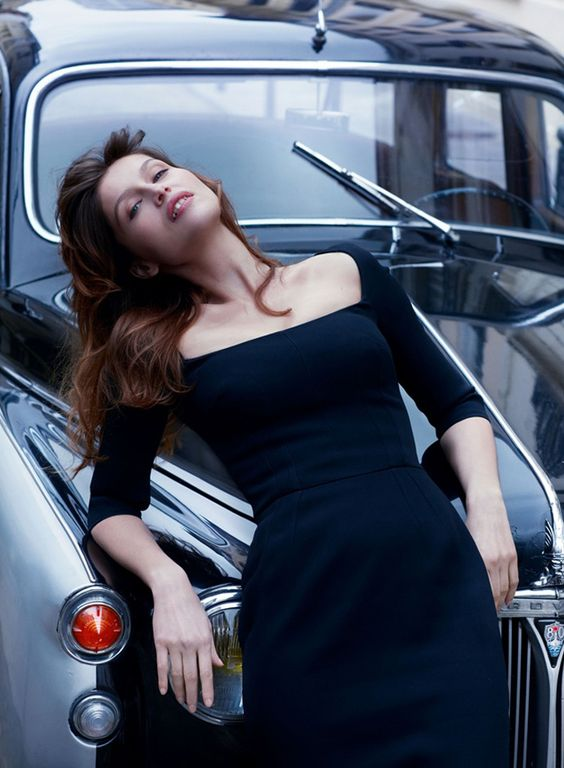 Laetitia Casta in Dolce&Gabbana SS2014 in Vanity Fair Italy *  Laetitia Casta wears black long sleeved shift dress by Dolce&Gabbana SS14.