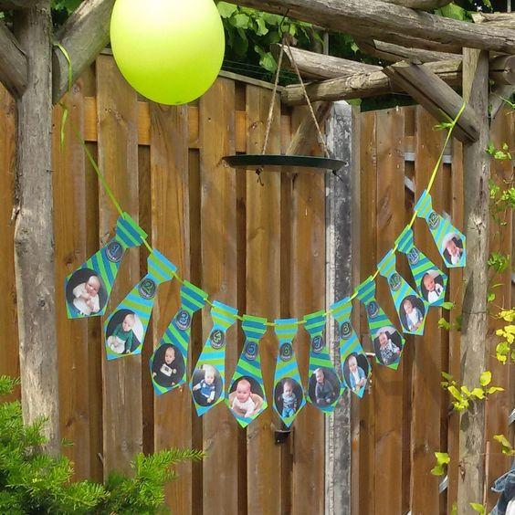 Verjaardagsslinger. 12 stropdasjes met daarop foto's van 1 maand oud t/m 12 maanden oud. Zo zie je hoe hard hij is gegroeid!