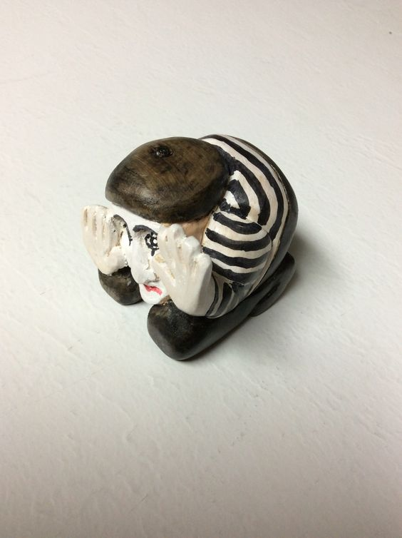 Mime in a box, 2 inch square.