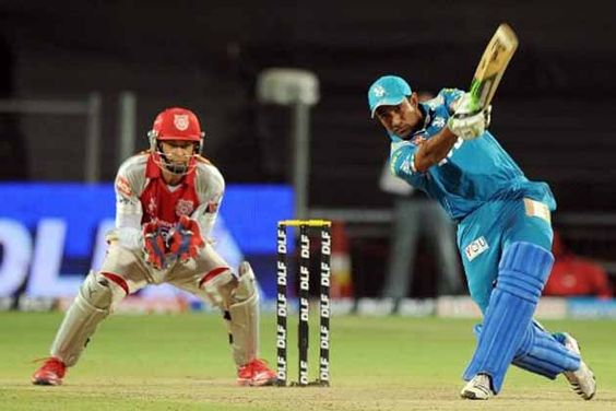 Robin Uthappa hits a six during his innings of 40 against Kings XI Punjab in Pune.