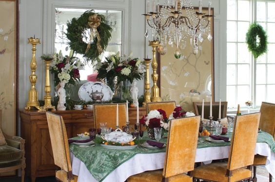 Beautiful Christmas decor in an elegant dining room with orange velvet chairs - Sybil Sylvester