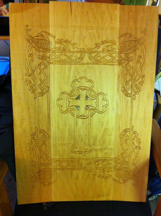 Chip carved  Celtic Cross surrounded by birds of paradise  protective guardians