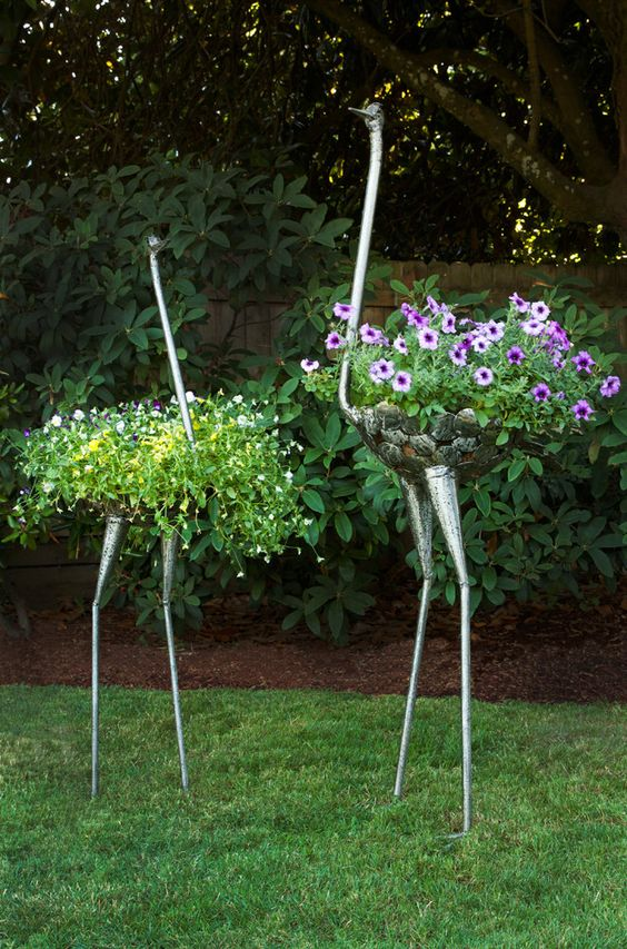 These creative ostrich plant holders are designed to showcase flowers artfully, as the contents of the round basket you include mimic an ostrich's plumes.: