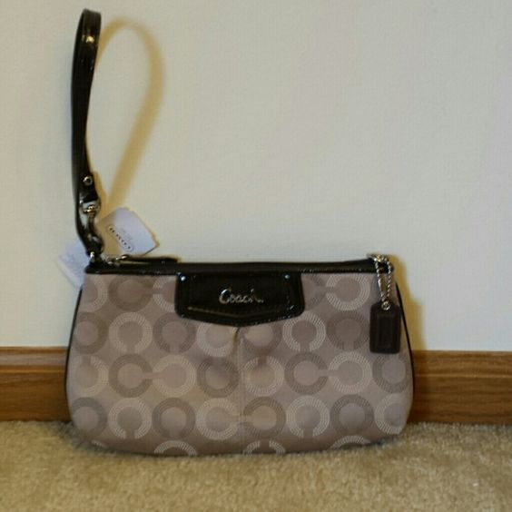 """Coach Genuine Signature large wristlet This Coach wristlet is the perfect fall color! Goes with everything.  Has convertible handle, leather trim and Coach leather hangtag. Inside are 8 credit card pockets and cell phone slip pocket.  Wonderful gift or for your personal use! Size is 9 1/2"""" across and 5 1/2"""" tall by 1 1/2"""" wide. Coach Bags Clutches & Wristlets"""