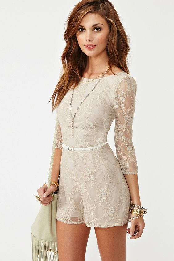 Metallic Lace Romper  Now $40.60  Was $58.00  Final sale  Sweet taupe lace romper featuring a scoop neckline and metallic silver threading. Pleated crop sleeves, detachable faux patent leather belt. Hook/eye and zip closure at back, partially lined. Looks cute paired with a long necklace and boots!