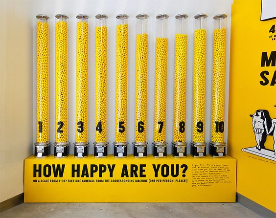 Interactive gum ball participatory exhibit. Vote your happiness level.  The Happy Show by Stefan Sagmeister:
