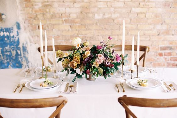 #tablescapes, #centerpiece, #table  Photography: Megan Robinson Photography - meganrobinsonblog.com Floral Design: Tinge - www.tingefloral.com/ Venue: Photo Collective Studios Natural Light Loft - photocollectivestudios.com/studio/natural-light-loft/  Read More: http://www.stylemepretty.com/2015/05/04/part-ii-organic-minimal-wedding-inspiration/