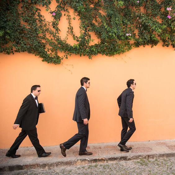 Www.amaranthweddingphotography.com   Destination wedding in San miguel de Allende, Mexico. groomsmen walking to the wedding, cobble stone street, Ivy, old city, street photography.