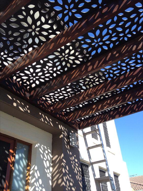 Roof screen on pergola to front door. Great shadowing effect :)