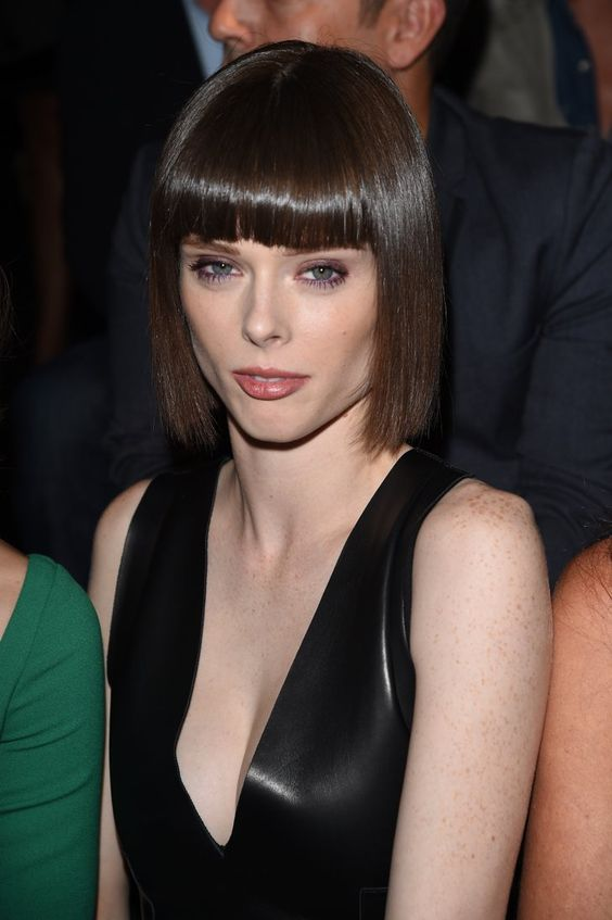Pin for Later: The Stars Were Sitting Pretty in the Milan Fashion Week Front Row Coco Rocha At DSquared2, Coco wore a purple hue on her waterline to make her blue eyes pop.