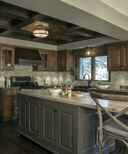 This custom kitchen brings rustic style to a new level of sophistication. Some of the beautiful features include knotty alder inset cabinets, custom grey painted island, hammered copper farm sink and custom hood.Dayna Flory Interiors Dayna Rasschaert - Birmingham, MI
