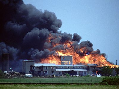 The Waco siege was a deadly 1993 siege of a Branch Davidians compound, by the US federal and Texas state law enforcement and military at the Mount Carmel Center ranch in the community of Elk, Texas, nine miles from Waco. A siege was initiated by the FBI, resulting in a much publicised 51 day standoff. Eventually, during an FBI launched assault involving tear gas, a fire engulfed Mount Carmel Center and 76 men, women, and children, including David Koresh, died.