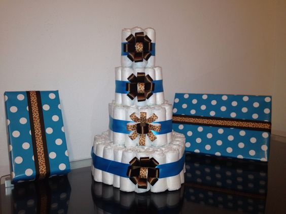 Diaper cake for a baby shower. Wrap gift boxes in cute colors for centerpieces
