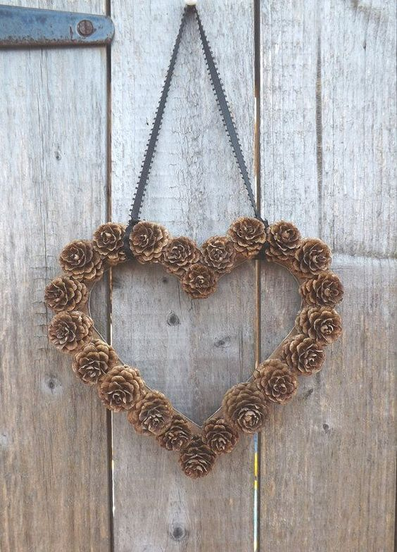 DIY Pine Cone Heart - Pine Cones are a great material for wreaths. Gotta love this heart wreath for a wedding!  Birch Creek Studio.: