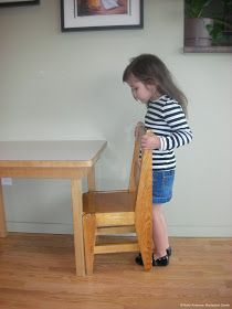 NAMC montessori grace and courtesy lesson resources toddlers infants preschoolers pushing in a chair