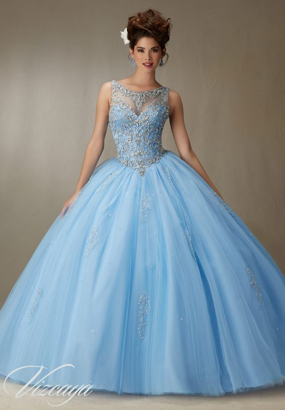 Quinceanera dresses by Vizcaya Embroidery and Beading on a Tulle Ball Gown Matching Stole.Colors: Bahama Blue, Blush, Champagne, White.