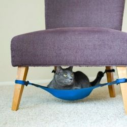 A clever hammock for cats that is easily secured underneath a regular chair or table, attaching to the legs. I could make this!