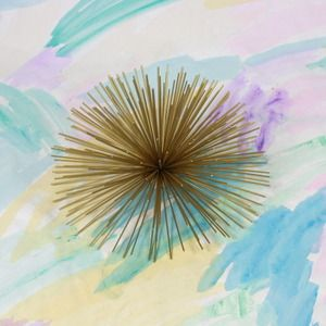 brass urchin- I have these on the wall- jayson home and garden