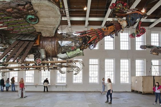 Massive phoenixes made of remnants from construction sites - by Xu Bing