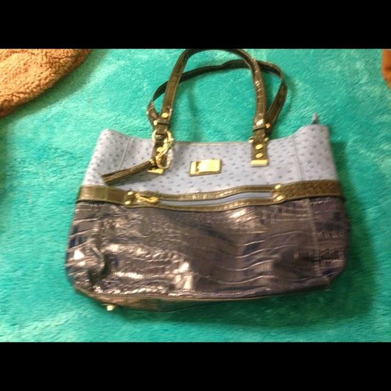 M.C. Handbag New M.C. Handbag navy crocodile at bottom and lighter blue ostrich on top several pockets inside zip pocket on front and zip pocket and cell phone pocket in back 3 compartments on inside with several other pockets Maddy Claire Bags