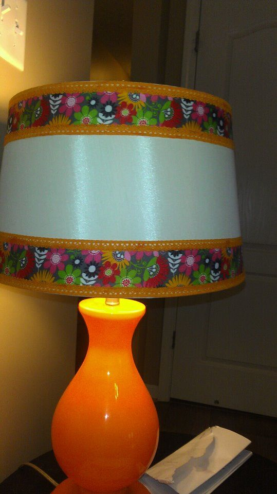 Made this with an old lamp shade a a pretty floral ribbon as well as some lace ribbon on the borders.