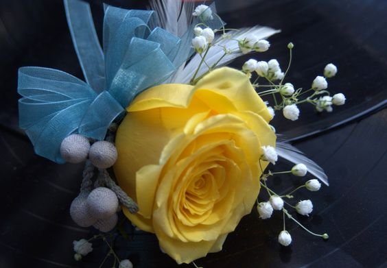 Another pin-on corsage but with a blue ribbon to accent the soft yellow.